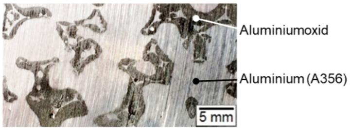 Schliffbild eines Metall-Keramik-Durchdringungsverbundwerkstoffes (c)